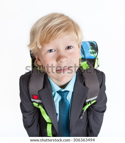 Portrait of scholar with school backpack looking at camera, isolated on white background - stock photo