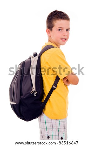 Portrait of school boy standing with scholl bag, isolated on white - stock photo