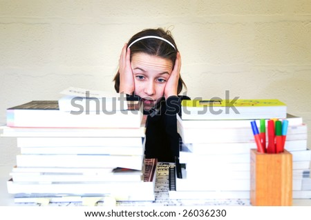 portrait of school girl with too much homework - stock photo