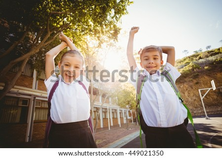 Portrait of school kids having a fun in campus at school - stock photo