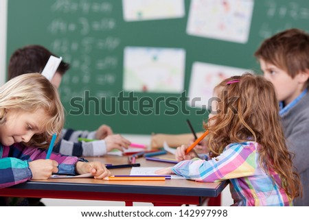 Portrait of schoolchildren having a group work in school