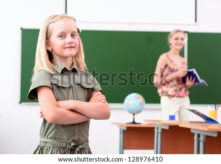 portrait of schoolgirl crossed her arms and looked at the camera