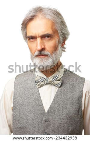 Portrait of scowl suspicious aged caucasian man with a grey beard and bowtie isolated on white background - stock photo