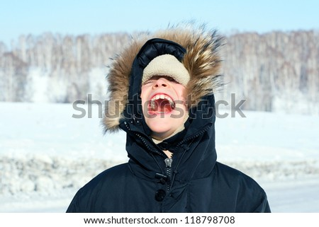 Portrait of Screaming Boy in the Winter - stock photo