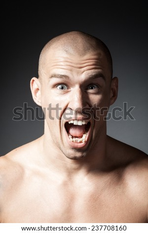 portrait of screaming man isolated on gray background - stock photo
