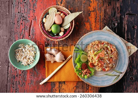 portrait of seafood pad thai with some ingredients - stock photo