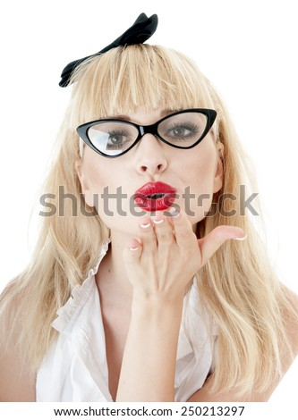 Portrait of seductive businesswoman wearing glasses on white background. Woman makes kissing lips.