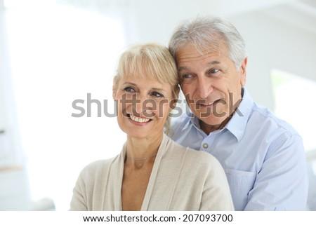 Portrait of senior and happy senior couple - stock photo
