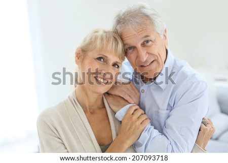 Portrait of senior and happy senior couple - stock photo