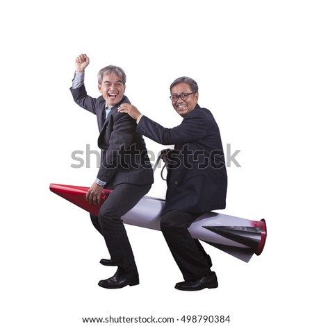 portrait of senior asian business man playing riding on rocket happiness emotion isolate white background
