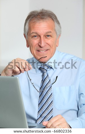 Portrait of senior businessman in office - stock photo