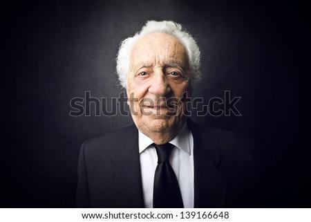 portrait of senior businessman smiling - stock photo