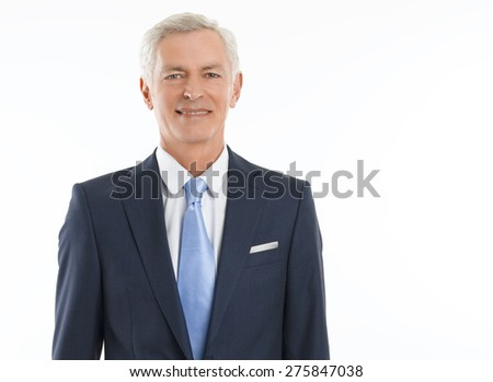 Portrait of senior businessman standing against white background and looking at camera. Isolated on white background. - stock photo