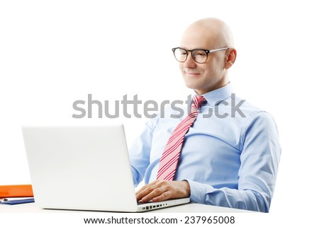 Portrait of senior businessman with laptop working on business strategy while sitting against white backround. - stock photo