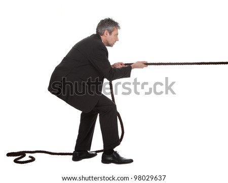 Portrait of senior businessmen pulling a rope. Isolated on white