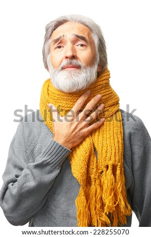 Portrait of senior caucasian man with gray hair and yellow scarf, holding his neck because of throat ache isolated on white background - stock photo