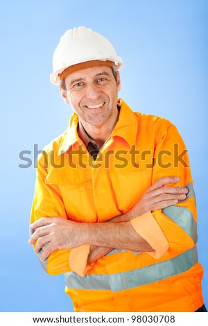 Portrait of senior construction worker wearing safety jacket on sky - stock photo