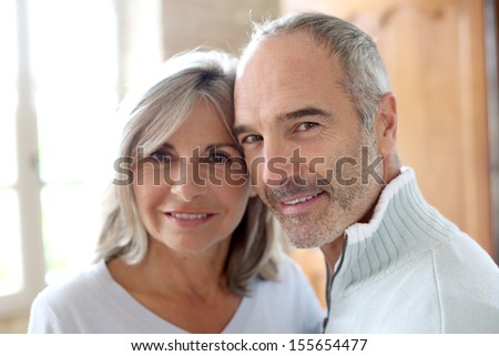 Portrait of senior couple at home