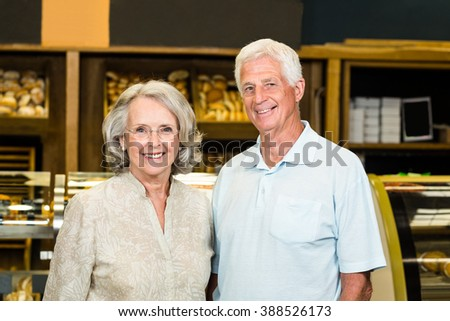 Portrait of senior couple at the bakery store