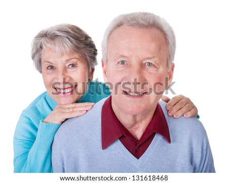 Portrait Of Senior Couple Enjoying Piggyback Isolated On White Background - stock photo