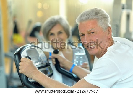 Portrait of senior Couple Exercising In gym