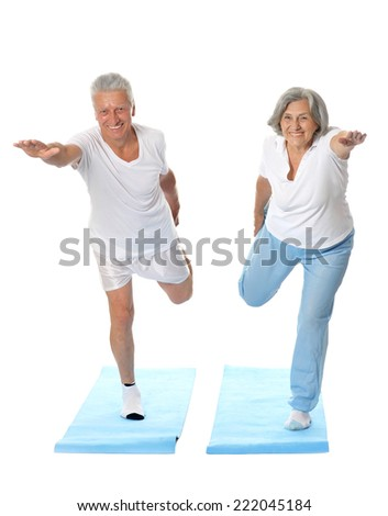 Portrait of senior couple exercising on a white background - stock photo