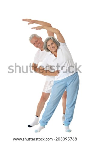 Portrait of Senior Couple Exercising On White Background - stock photo