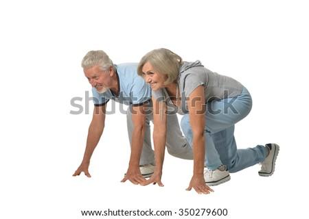 Portrait of Senior Couple Exercising On White Background - stock photo