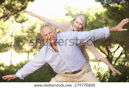 Portrait Of Senior Couple Having Fun In Countryside - stock photo