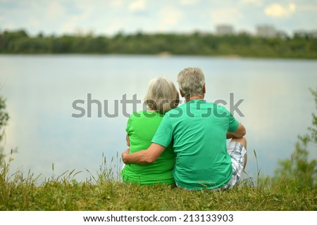 Portrait of senior couple near the river,view from the back