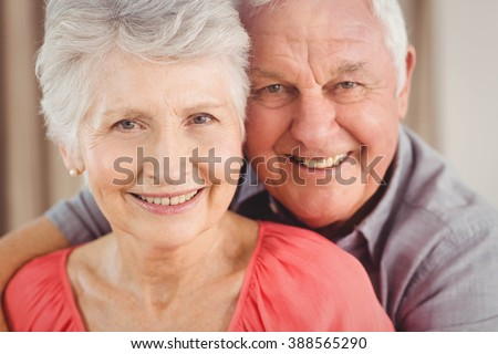 Portrait of senior couple smiling - stock photo