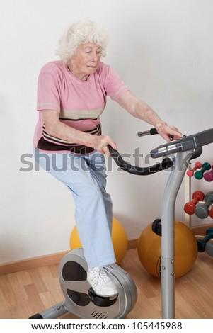Portrait of senior female doing physical exercise . - stock photo