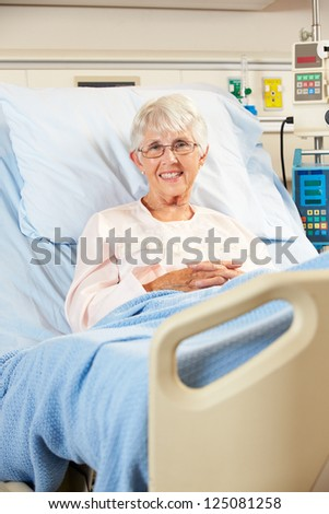 Portrait Of Senior Female Patient Relaxing In Hospital Bed - stock photo