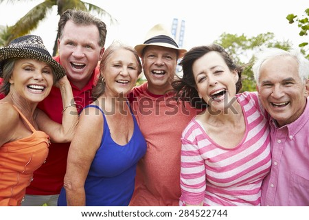 Portrait Of Senior Friends In Park Together - stock photo