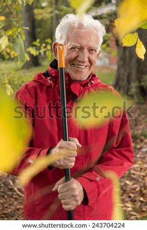 Portrait of senior gardener working at autumn day - stock photo