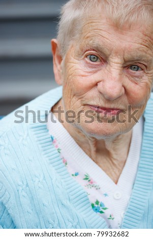 Portrait of senior lady in front of staircase