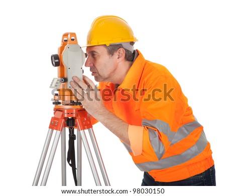 Portrait of Senior land surveyor working with theodolite. Isolated on white - stock photo