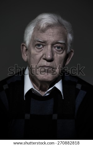 Portrait of senior lonely gloomy man - stock photo