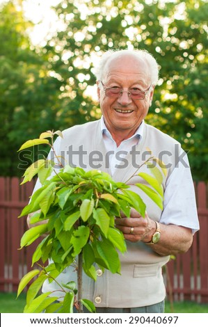 Portrait of senior man gardener