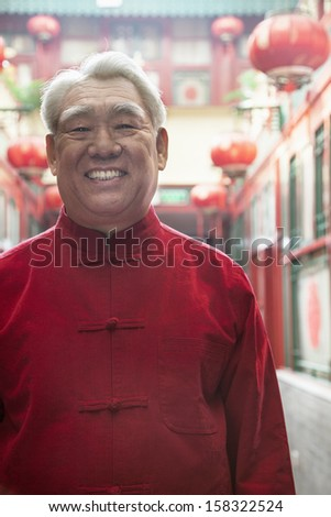 Portrait of senior man in Chinese traditional clothing - stock photo