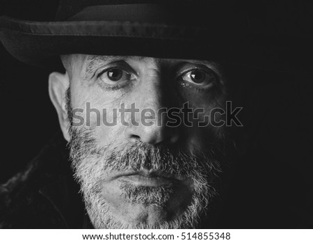Portrait of senior man in monochrome and low key