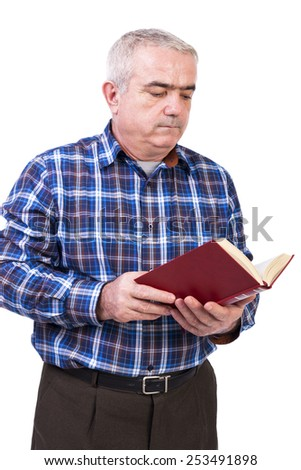 Portrait of senior man standing and reading a book over white background - stock photo