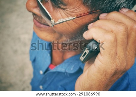 Portrait of senior man talking phone - stock photo