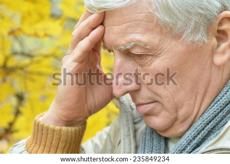 Portrait of senior man thinking about something outdoor - stock photo