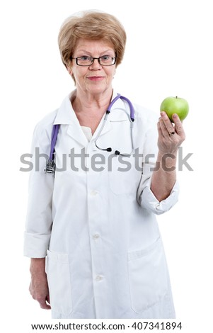 Portrait of senior medical professional with juicy green apple in hand, isolated on white background - stock photo