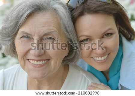 Portrait of senior mother and daughter outdoor - stock photo
