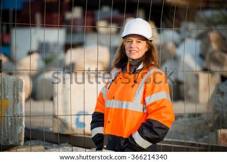 Portrait of senior woman engineer wearing protective workwear in work - stock photo