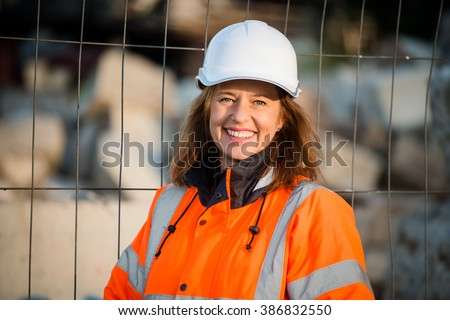 Portrait of senior woman engineer wearing protective workwear in work