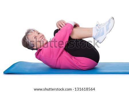 Portrait Of Senior Woman Exercising On White Background - stock photo