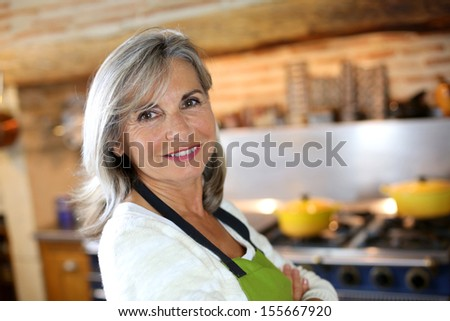 Portrait of senior woman in home kitchen